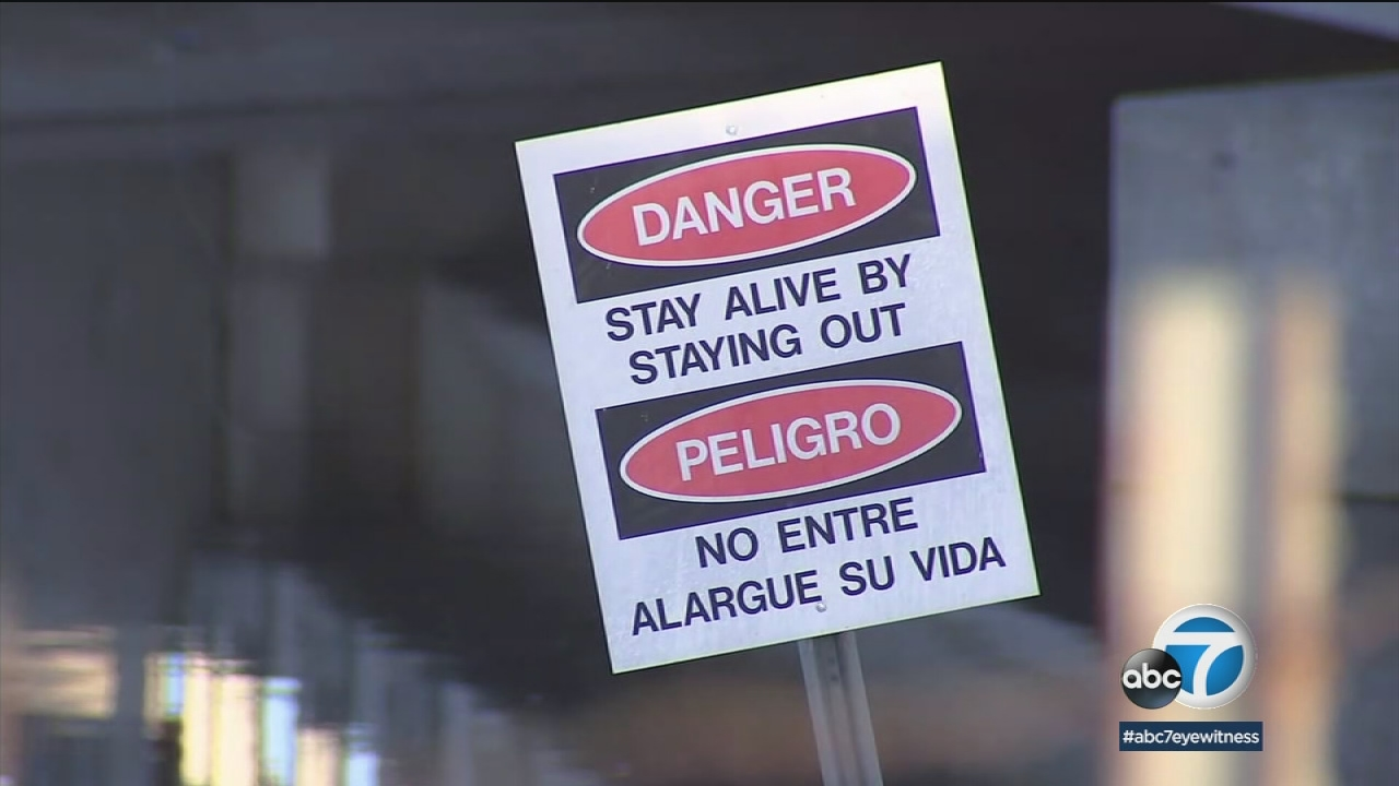 Warning signs are posted in the California Aqueduct in Hesperia.