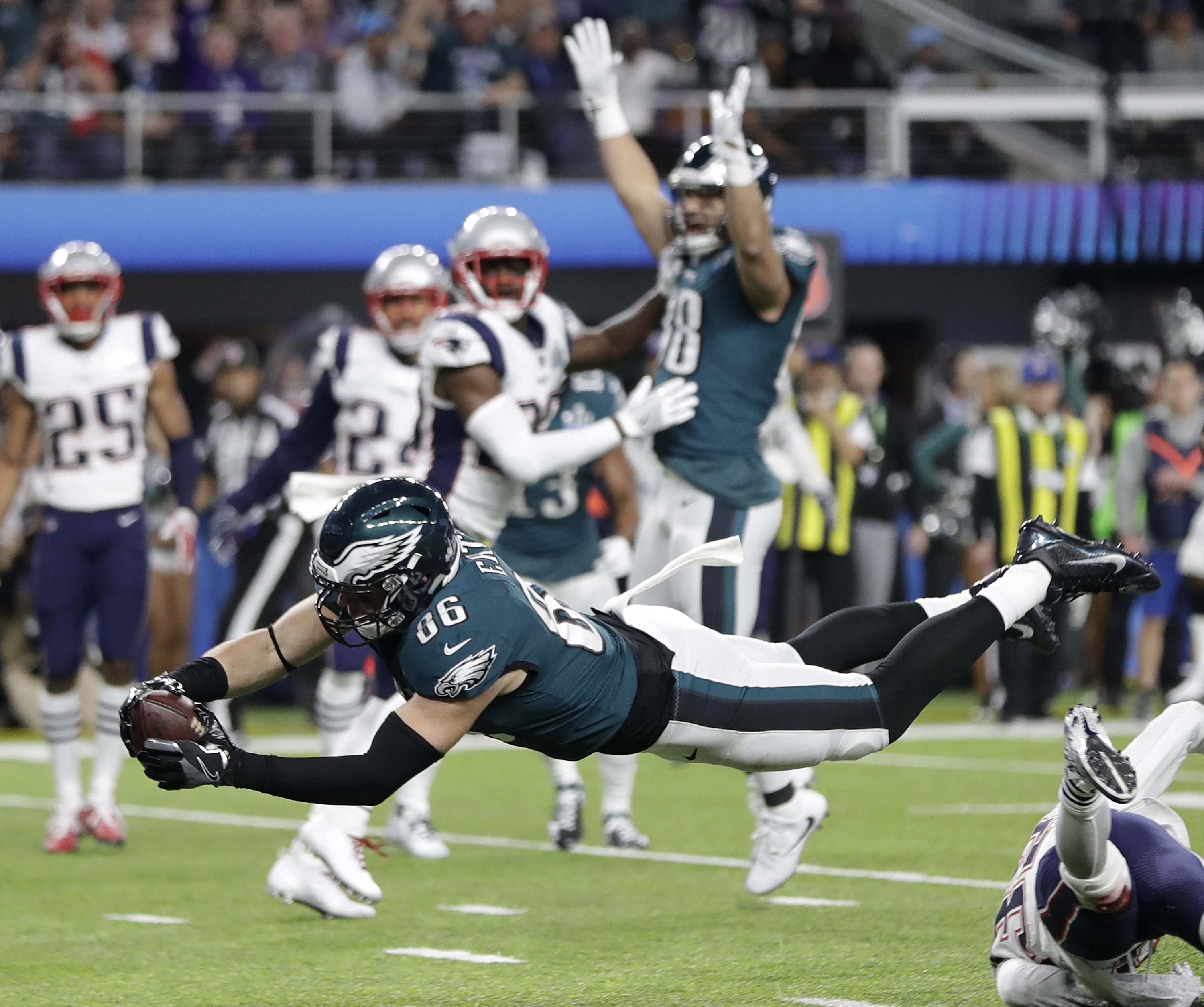 <div class='meta'><div class='origin-logo' data-origin='AP'></div><span class='caption-text' data-credit='AP Photo/Mark Humphrey'>Philadelphia Eagles' Zach Ertz dives into the end zone for a touchdown during the second half of the NFL Super Bowl 52 football game.</span></div>