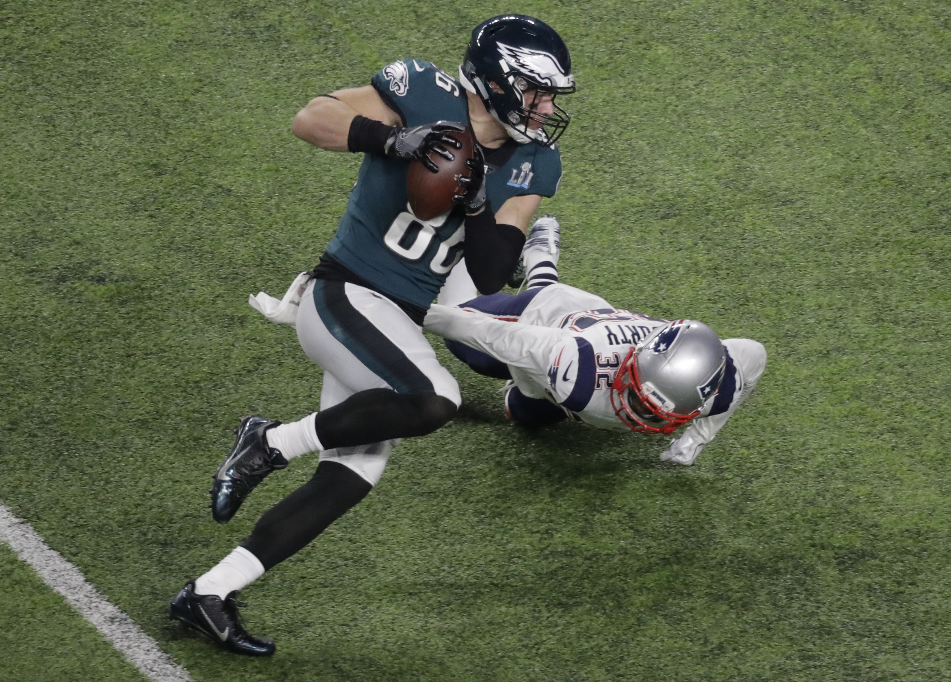 "<div class=""meta image-caption""><div class=""origin-logo origin-image ap""><span>AP</span></div><span class=""caption-text"">Philadelphia Eagles tight end Zach Ertz scores past New England Patriots free safety Devin McCourty during the second half of the NFL Super Bowl 52 football game. (AP Photo/Eric Gay)</span></div>"