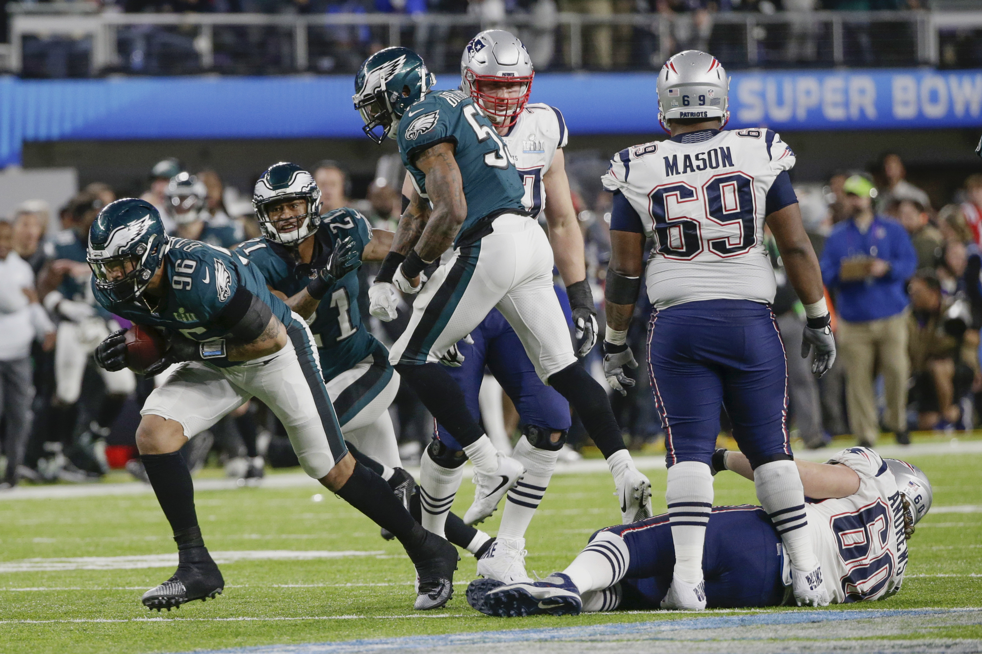<div class='meta'><div class='origin-logo' data-origin='AP'></div><span class='caption-text' data-credit='AP Photo/Tony Gutierrez'>Philadelphia Eagles defensive end Derek Barnett (96) recovers a fumble by New England Patriots quarterback Tom Brady, during the second half.</span></div>