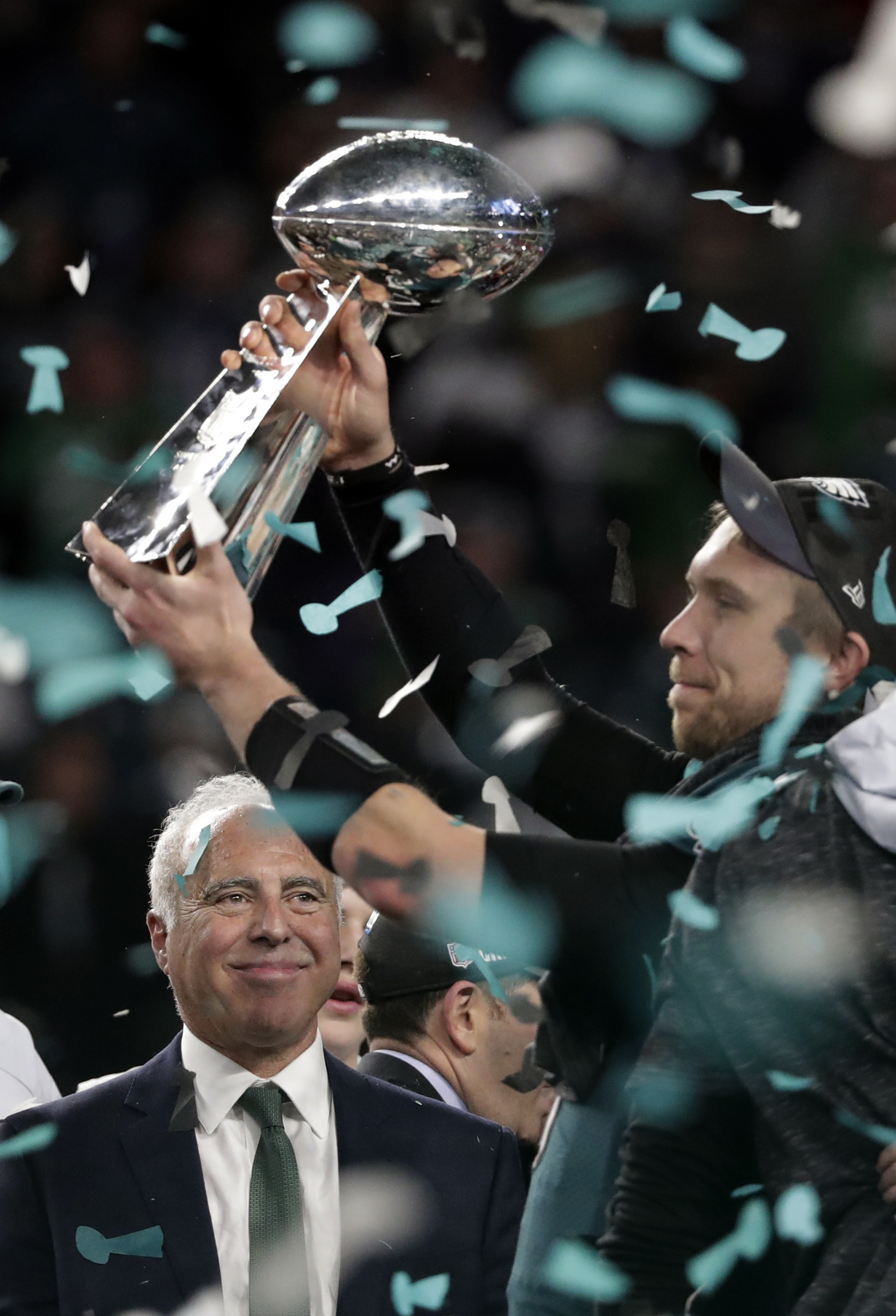 "<div class=""meta image-caption""><div class=""origin-logo origin-image ap""><span>AP</span></div><span class=""caption-text"">Philadelphia Eagles quarterback Nick Foles hoists the Vincent Lombardi trophy as owner Jeffrey Lurie, smiles after winning the NFL Super Bowl 52 football game. (AP Photo/Tony Gutierrez)</span></div>"