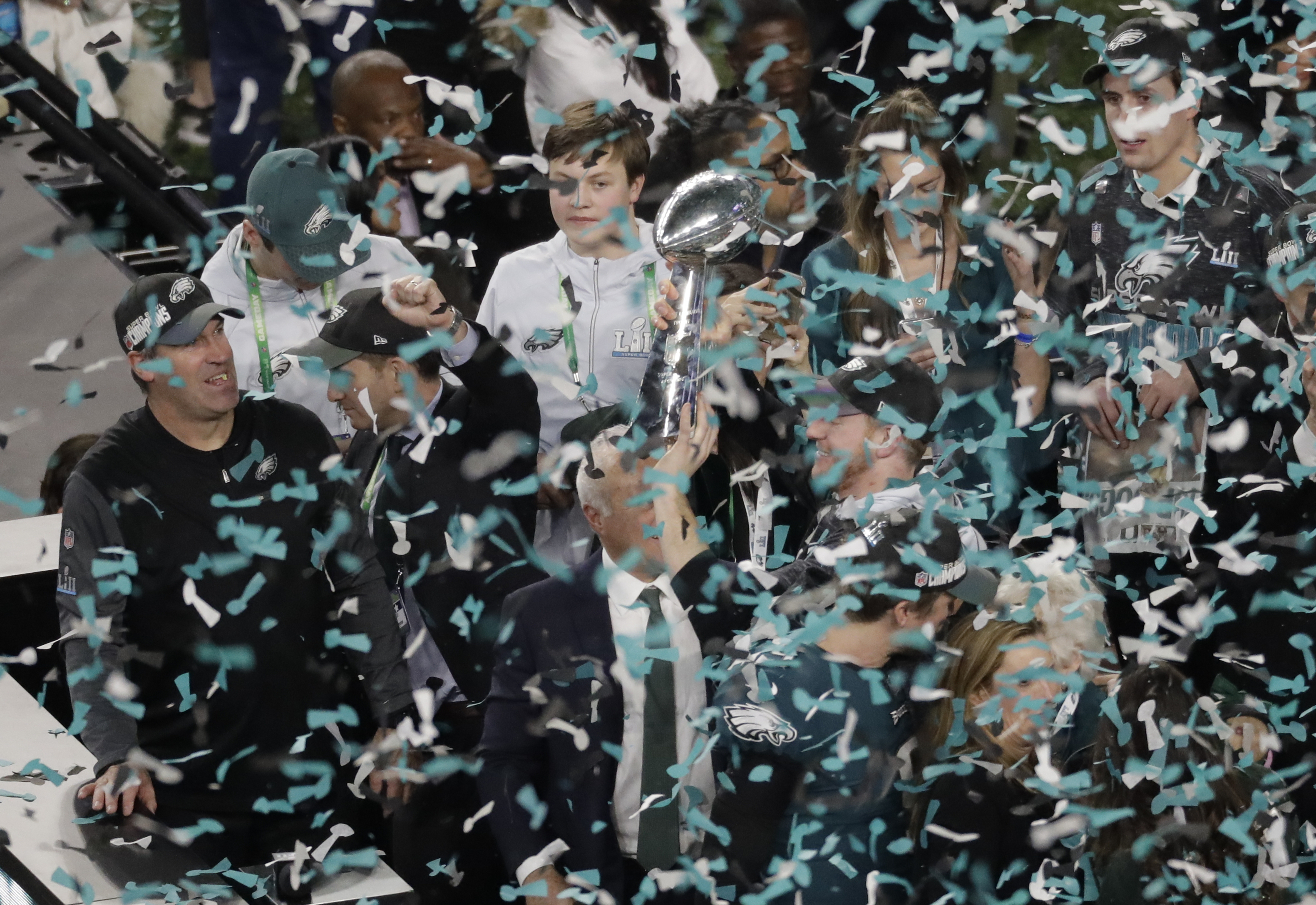"<div class=""meta image-caption""><div class=""origin-logo origin-image ap""><span>AP</span></div><span class=""caption-text"">Philadelphia Eagles quarterback Carson Wentz hoists the Vincent Lombardi trophy after the NFL Super Bowl 52 football game against the New England Patriots. (AP Photo/Eric Gay)</span></div>"