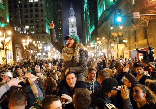 <div class='meta'><div class='origin-logo' data-origin='none'></div><span class='caption-text' data-credit='AP'>Philadelphia Eagles fan celebrate the team's victory in Super Bowl LII on Sunday, Feb. 4, 2018. (AP Photo/Julio Cortez)</span></div>