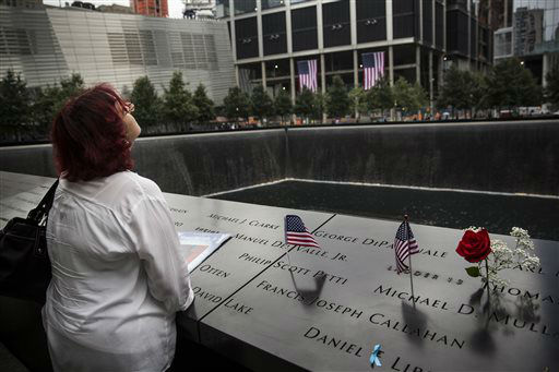 "<div class=""meta image-caption""><div class=""origin-logo origin-image none""><span>none</span></div><span class=""caption-text"">A woman stands in silence during memorial observances on the 13th anniversary of the Sept. 11 terror attacks on the World Trade Center. (AP Photo/ Andrew Burton)</span></div>"