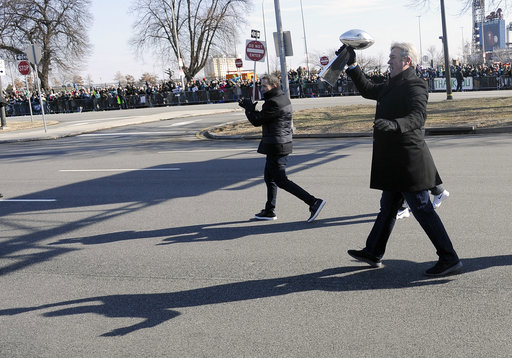 "<div class=""meta image-caption""><div class=""origin-logo origin-image ap""><span>AP</span></div><span class=""caption-text"">Philadelphia Eagles head coach Doug Pederson, and executive VP Howie Roseman walk with the Lombardi Trophy during the Super Bowl LII victory parade. (AP Photo/Michael Perez) (AP)</span></div>"