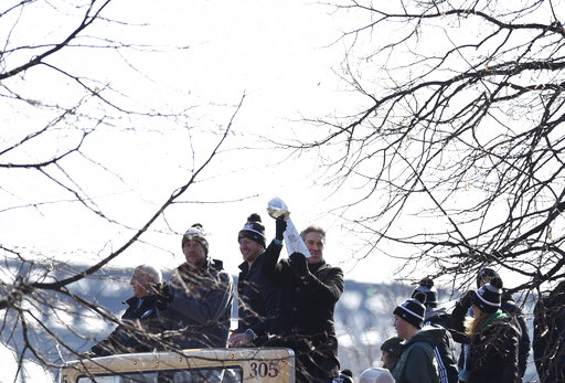 "<div class=""meta image-caption""><div class=""origin-logo origin-image ap""><span>AP</span></div><span class=""caption-text"">Philadelphia Eagles head coach holds up the Vince Lombardi Trophy with quarterbacks Carson Wentz and Nick Foles during the Super Bowl LII victory parade. (AP Photo/Michael Perez) (AP)</span></div>"