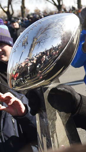 <div class='meta'><div class='origin-logo' data-origin='AP'></div><span class='caption-text' data-credit='AP'>Philadelphia Eagles head coach Doug Pederson carries the Lombardi Trophy past fans during the Super Bowl LII victory parade, Thursday, Feb 8, 2018. (AP Photo/Michael Perez)</span></div>