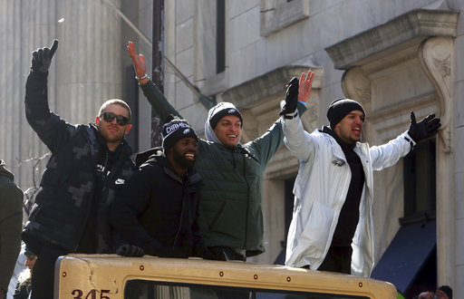 "<div class=""meta image-caption""><div class=""origin-logo origin-image ap""><span>AP</span></div><span class=""caption-text"">Philadelphia Eagles wide receivers Zach Ertz, and Mack Hollins ride with teammates in the Eagles team parade Thursday Feb. 8, 2018, in Philadelphia. (AP Photo/Jacqueline Larma) (AP)</span></div>"