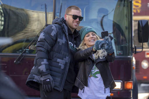 <div class='meta'><div class='origin-logo' data-origin='AP'></div><span class='caption-text' data-credit='AP'>Zach Ertz, left, stops to take a photo with his wife, Julie Ertz, during a Super Bowl victory parade, Thursday, Feb. 8, 2018 (AP Photo/Christopher Szagola)</span></div>