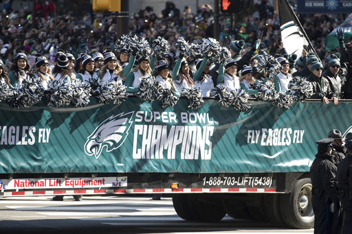 <div class='meta'><div class='origin-logo' data-origin='AP'></div><span class='caption-text' data-credit='AP'>Philadelphia Eagles cheerleaders waves during a Super Bowl victory parade, Thursday, Feb. 8, 2018, in Philadelphia (AP Photo/Christopher Szagola)</span></div>