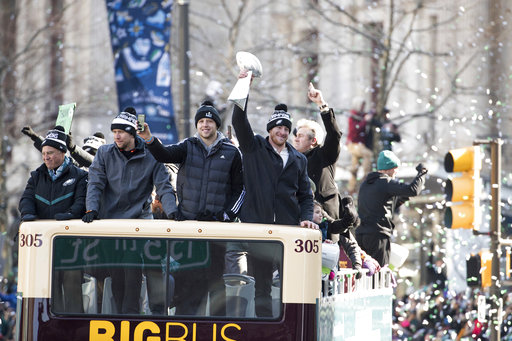 <div class='meta'><div class='origin-logo' data-origin='AP'></div><span class='caption-text' data-credit='AP'>Carson Wentz holds up the Lombardi trophy with Nate Sudfeld, Nick Foles and owner Jeffrey Lurie during a Super Bowl victory parade, Feb. 8, 2018 (AP Photo/Christopher Szagola)</span></div>