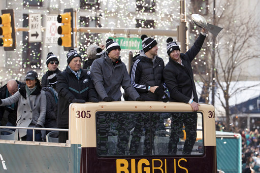 <div class='meta'><div class='origin-logo' data-origin='AP'></div><span class='caption-text' data-credit='AP'>Philadelphia Eagles owner Jeffrey Lurie and quarterbacks Nick Foles, Nate Sudfeld and Carson Wentz, holding the Lombardi Trophy, celebrate during a Super Bowl victory parade</span></div>