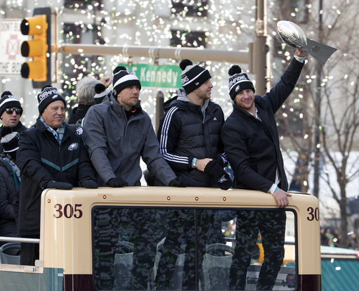 <div class='meta'><div class='origin-logo' data-origin='AP'></div><span class='caption-text' data-credit='AP'>Carson Wentz holds up the Lombardi trophy as he rides with fellow quarterbacks Nate Sudfeld, Nick Foles, and team owner Jeffrey Lurie (AP Photo/Christopher Szagola)</span></div>