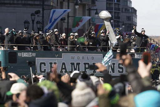 <div class='meta'><div class='origin-logo' data-origin='AP'></div><span class='caption-text' data-credit='AP'>The Philadelphia Eagles celebrate as they hold up a replica of the Vince Lombardi Trophy during a Super Bowl victory parade, Thursday, Feb. 8, 2018 (AP Photo/Christopher Szagola)</span></div>