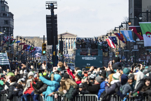 <div class='meta'><div class='origin-logo' data-origin='AP'></div><span class='caption-text' data-credit='AP'>Philadelphia Eagles celebrate as the parade heads towards the Philadelphia Museum of Art during a Super Bowl victory parade. (AP Photo/Christopher Szagola)</span></div>