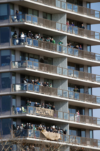 "<div class=""meta image-caption""><div class=""origin-logo origin-image ap""><span>AP</span></div><span class=""caption-text"">Fans line balconies before a Super Bowl victory parade for the Philadelphia Eagles football team, Thursday, Feb. 8, 2018, in Philadelphia. (AP Photo/Alex Brandon) (AP)</span></div>"
