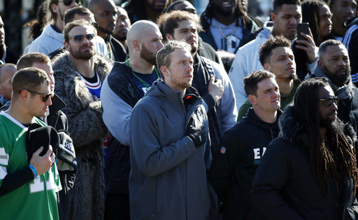 "<div class=""meta image-caption""><div class=""origin-logo origin-image ap""><span>AP</span></div><span class=""caption-text"">Philadelphia Eagles quarterback Nick Foles stands during the national anthem in front of the Philadelphia Museum of Art after a Super Bowl victory parade. (AP Photo/Alex Brandon) (AP)</span></div>"