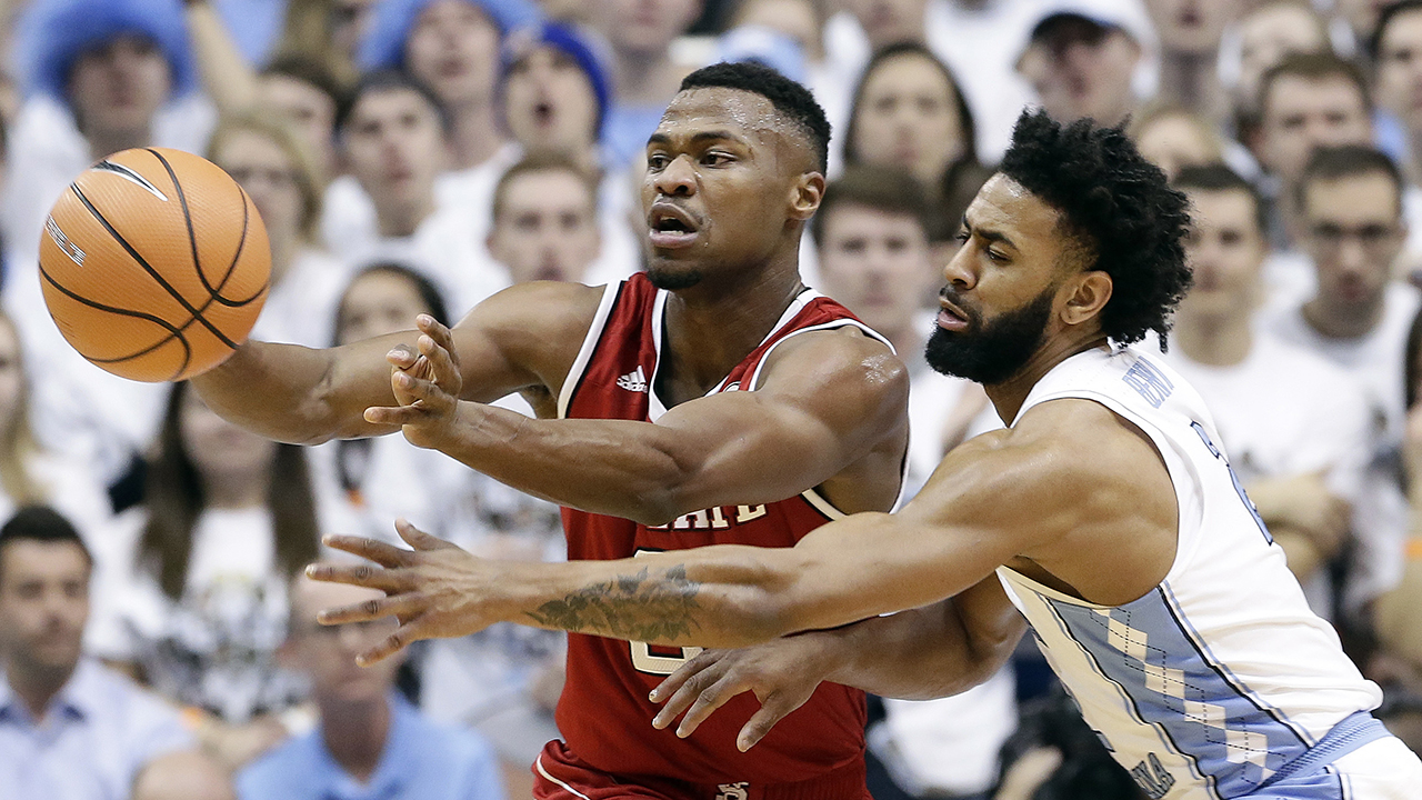 NC State's Torin Dorn passes against UNC's Joel Berry on Jan. 27 in the first matchup between the Tobacco Road rivals.