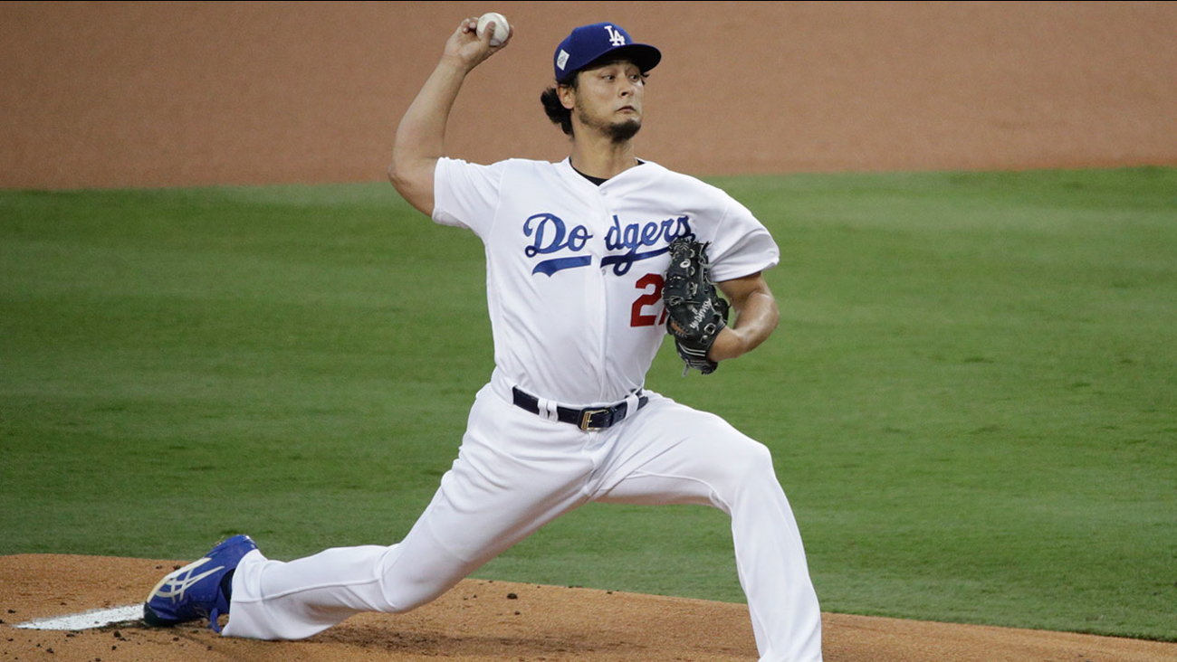 FILE - In this Nov. 1, 2017, file photo, Dodgers pitcher Yu Darvish, of Japan, throws against the Houston Astros during the first inning of Game 7 of baseball's World Series in LA.
