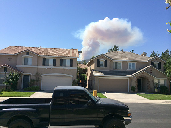"""<div class=""""meta image-caption""""><div class=""""origin-logo origin-image """"><span></span></div><span class=""""caption-text"""">Smoke from a brush fire in Silverado Canyon is seen from Corona in this photo from an ABC7 viewer on Friday, Sept. 12, 2014. (ABC7 viewer)</span></div>"""