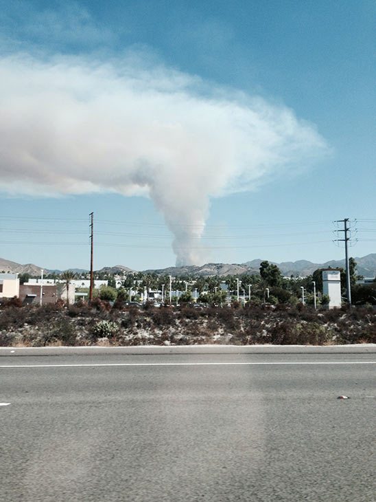 """<div class=""""meta image-caption""""><div class=""""origin-logo origin-image """"><span></span></div><span class=""""caption-text"""">Smoke from a brush fire in Silverado Canyon is seen from State Route 241 toll road in Foothill Ranch in this photo from an ABC7 viewer on Friday, Sept. 12, 2014. (ABC7 viewer)</span></div>"""