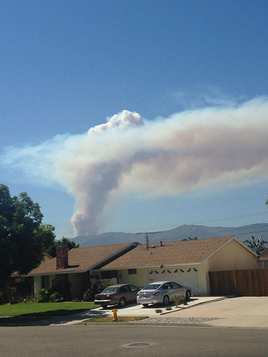 """<div class=""""meta image-caption""""><div class=""""origin-logo origin-image """"><span></span></div><span class=""""caption-text"""">Smoke from a brush fire in Silverado Canyon is seen in this photo from an ABC7 viewer on Friday, Sept. 12, 2014. (ABC7 viewer)</span></div>"""