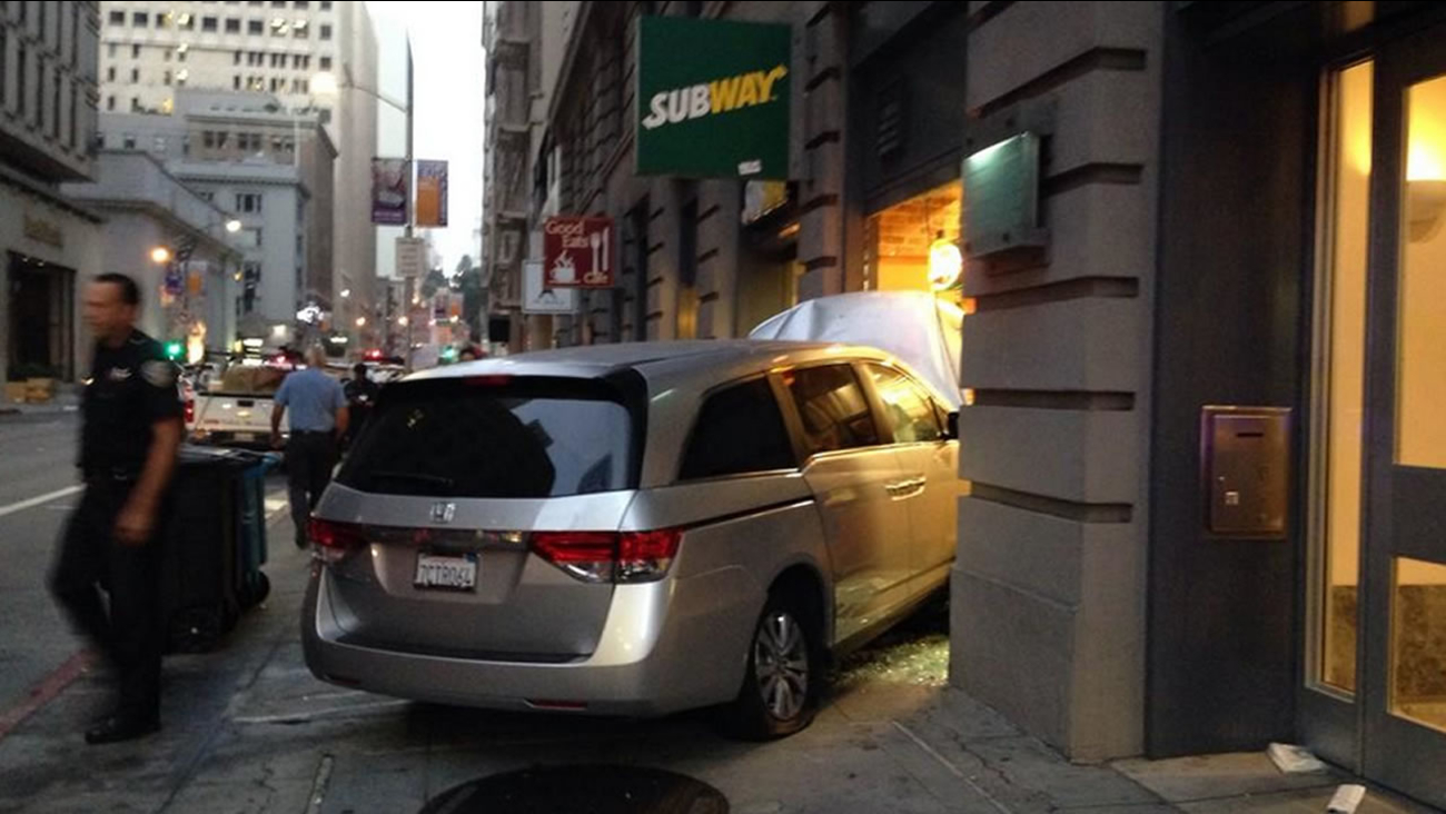 San Francisco police cited a woman for running a red light in San Francisco, causing another car to crash into a Subway restaurant on Pine Street Friday morning.