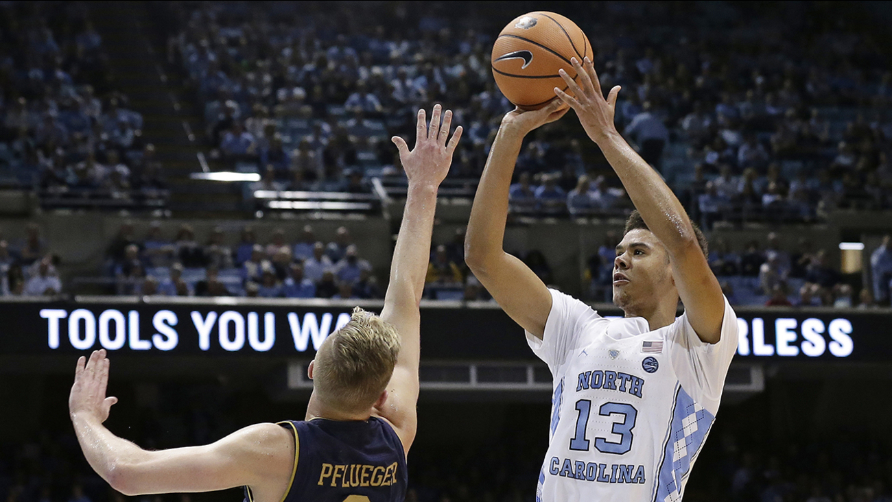 North Carolina's Cameron Johnson shoots over Notre Dame's Rex Pflueger on Monday in Chapel Hill.