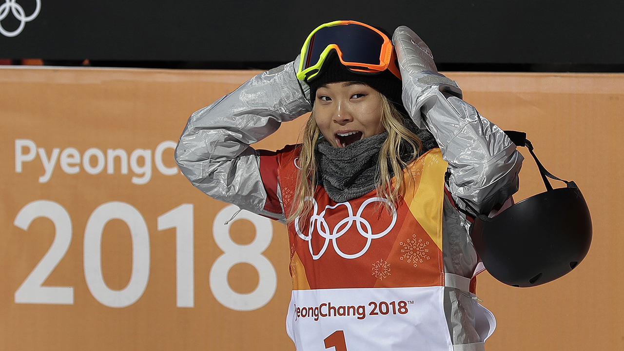 Chloe Kim of the United States reacts to her score during the women's halfpipe finals.