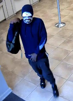 "<div class='meta'><div class='origin-logo' data-origin='none'></div><span class='caption-text' data-credit=''>The suspect is described as a black male in his middle 20's, approximately 5'10"" tall, thin build.  He wore a skull mask that covered the lower half of his face.</span></div>"
