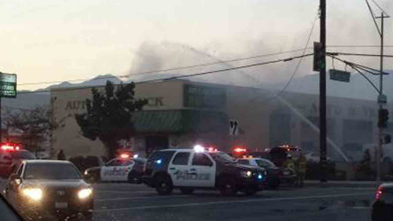 Firefighters respond to the scene of a fire at an auto body shop in the 16000 block of Arrow Highway in Irwindale Saturday, Sept. 13, 2014.