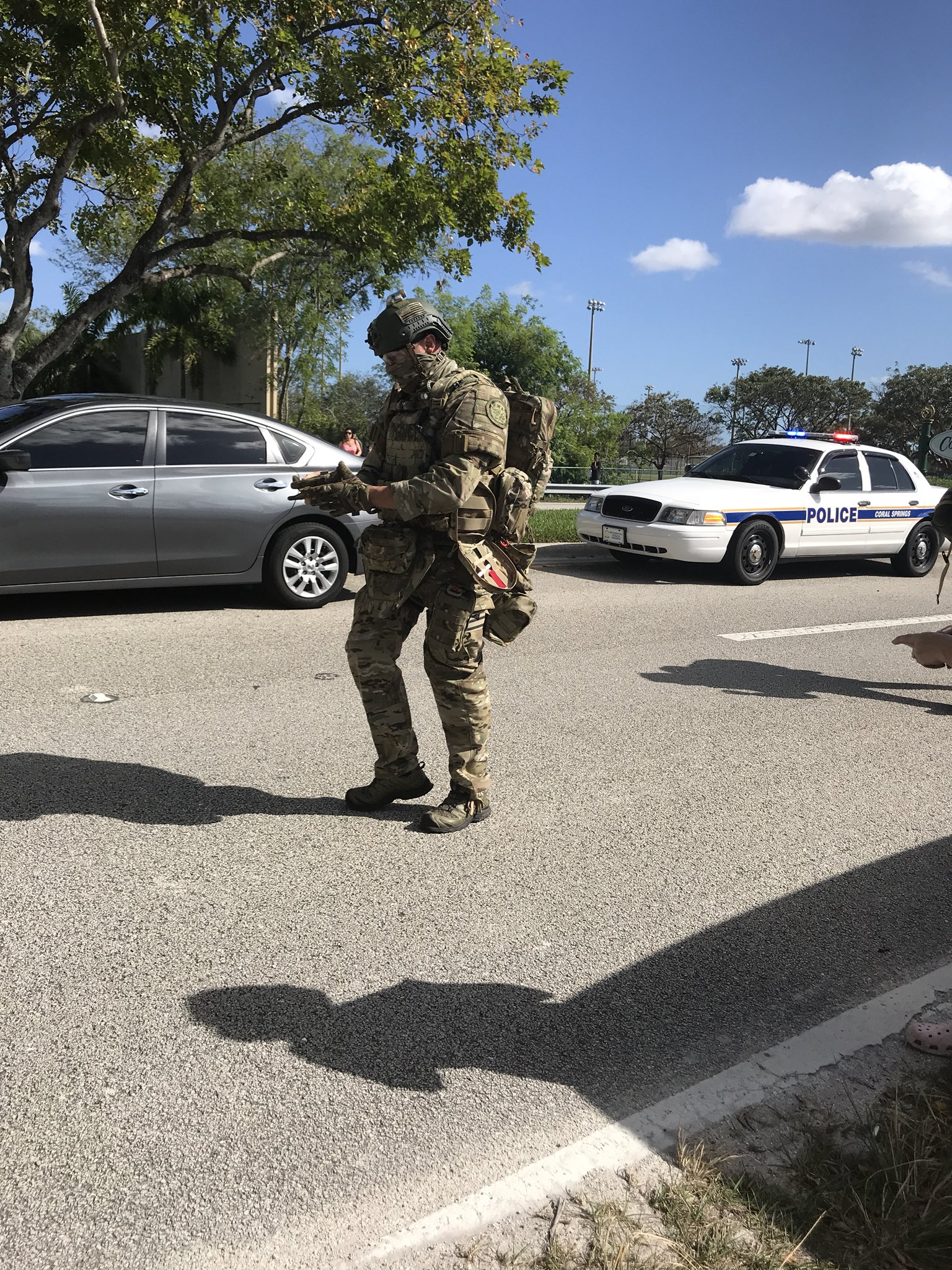 <div class='meta'><div class='origin-logo' data-origin='Creative Content'></div><span class='caption-text' data-credit='grumpyhaus/Twitter'>Photos show a police response to reports of shots fired at a Florida high school.</span></div>