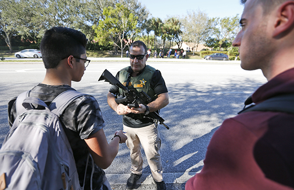 "<div class=""meta image-caption""><div class=""origin-logo origin-image ap""><span>AP</span></div><span class=""caption-text"">A law enforcement officer talks with students, Wednesday, Feb. 14, 2018, in Parkland, Fla. (AP Photo/Wilfredo Lee)</span></div>"