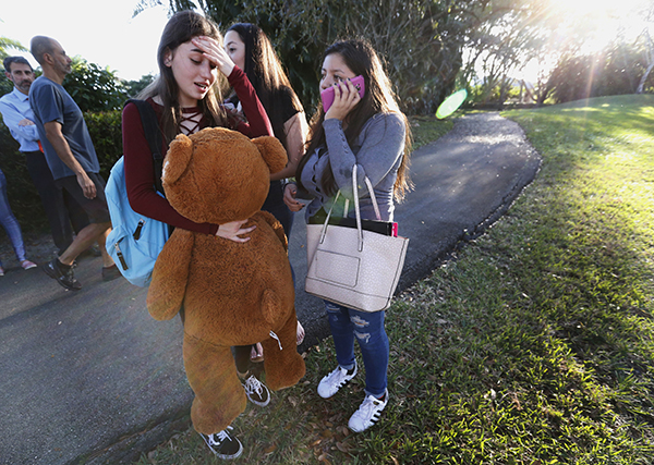 "<div class=""meta image-caption""><div class=""origin-logo origin-image ap""><span>AP</span></div><span class=""caption-text"">Students wait to be picked up after a shooting at Marjory Stoneman Douglas High School in Parkland, Fla., Wednesday, Feb. 14, 2018. (AP Photo/Wilfredo Lee)</span></div>"