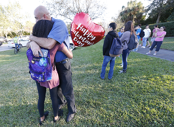 "<div class=""meta image-caption""><div class=""origin-logo origin-image ap""><span>AP</span></div><span class=""caption-text"">Family member embrace following a shooting at Marjory Stoneman Douglas High School, Wednesday, Feb. 14, 2018, in Parkland, Fla. (AP Photo/Wilfredo Lee)</span></div>"