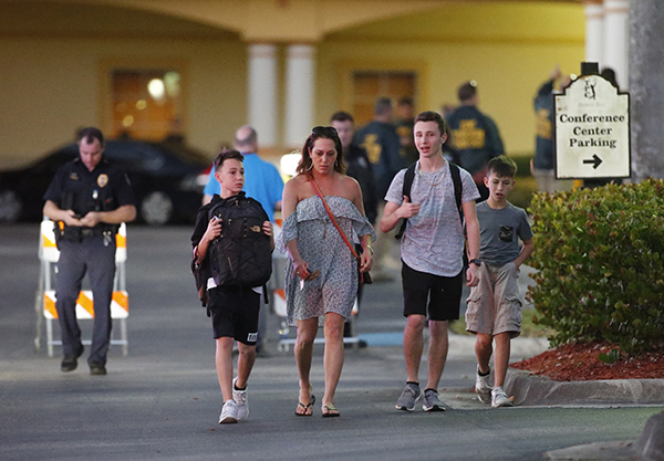 "<div class=""meta image-caption""><div class=""origin-logo origin-image ap""><span>AP</span></div><span class=""caption-text"">Family members pick up students of Marjory Stoneman Douglas High School in Parkland, Fla., at a nearby hotel, Wednesday, Feb. 14, 2018. (AP Photo/Wilfredo Lee)</span></div>"