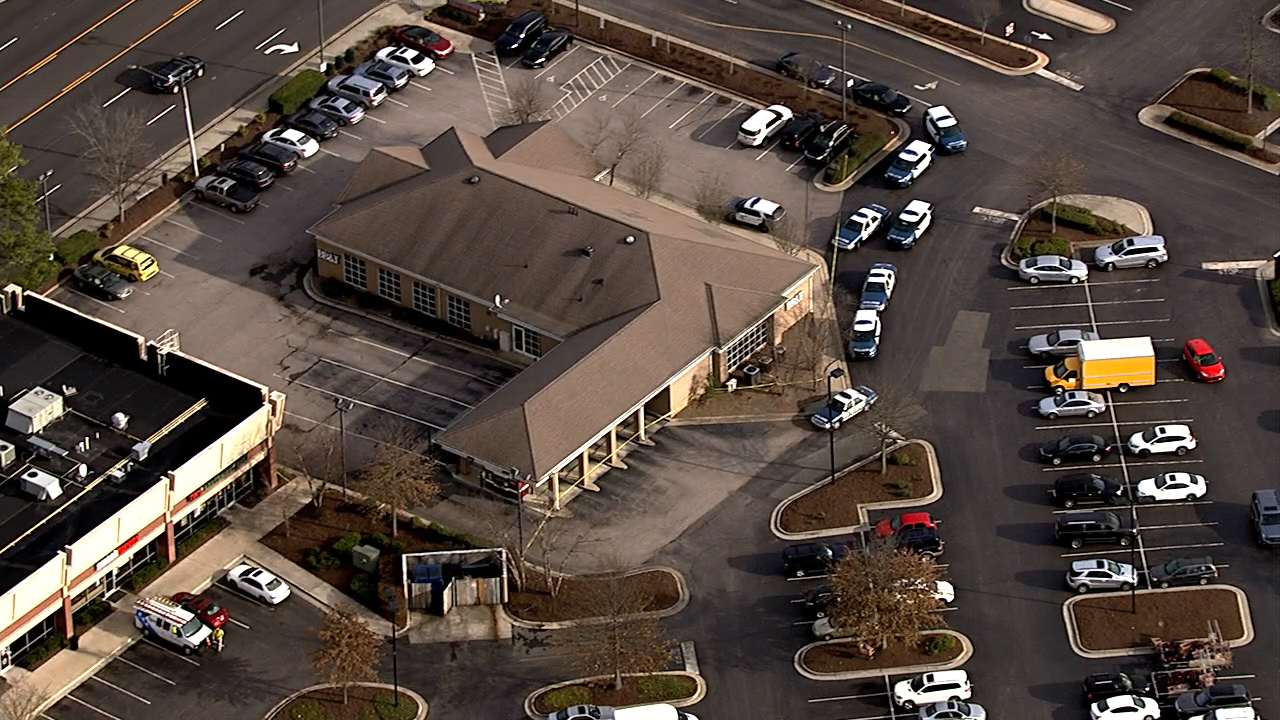 Raleigh Police descend on a BB&T branch Thursday in the 6600 block of Falls of Neuse Road.