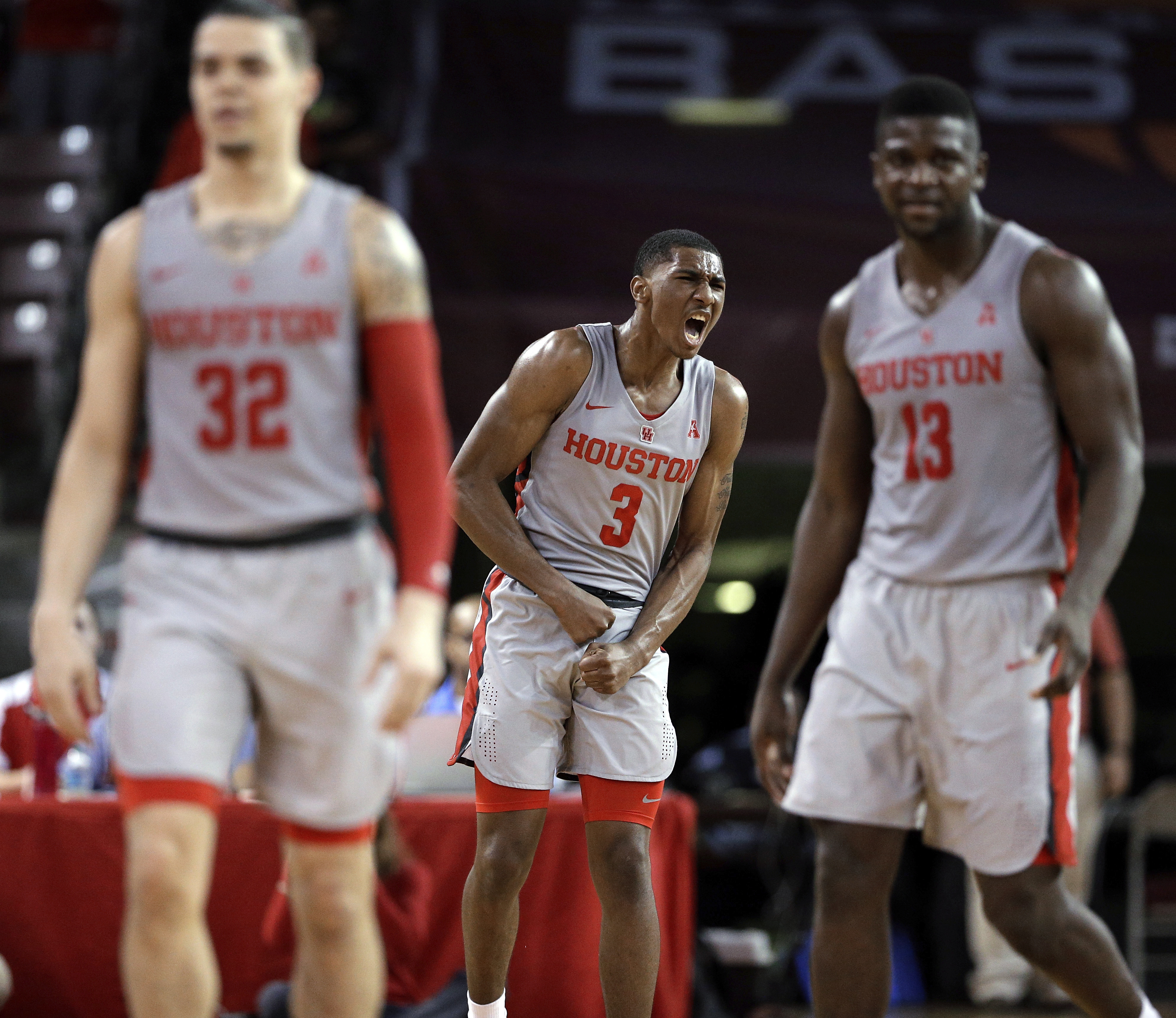 <div class='meta'><div class='origin-logo' data-origin='AP'></div><span class='caption-text' data-credit='Michael Wyke'>Houston guard Armoni Brooks (3) reacts after making a 3-point shot as guard Rob Gray (32) and forward Nura Zanna (13) head for the bench during a timeout in the second half.</span></div>