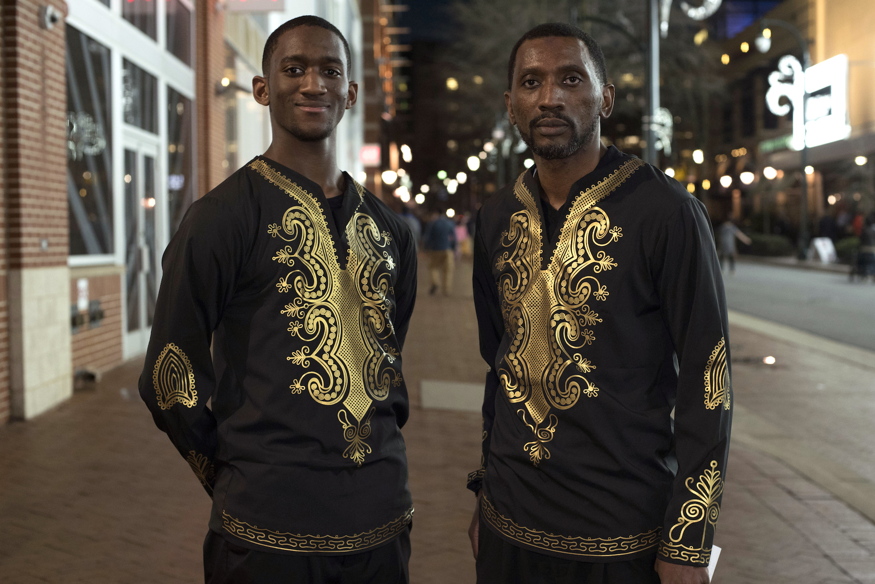 <div class='meta'><div class='origin-logo' data-origin='AP'></div><span class='caption-text' data-credit='AP Photo/Sait Serkan Gurbuz'>Khalel Robinson, left, poses with his father Jossan Robinson before seeing Black Panther in Silver Spring, Md., Thursday, Feb. 15, 2018.</span></div>