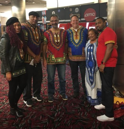 <div class='meta'><div class='origin-logo' data-origin='Creative Content'></div><span class='caption-text' data-credit='Meisha Robinson'>Meisha Robinson and friends attend a screening of &#34;Black Panther.&#34;</span></div>