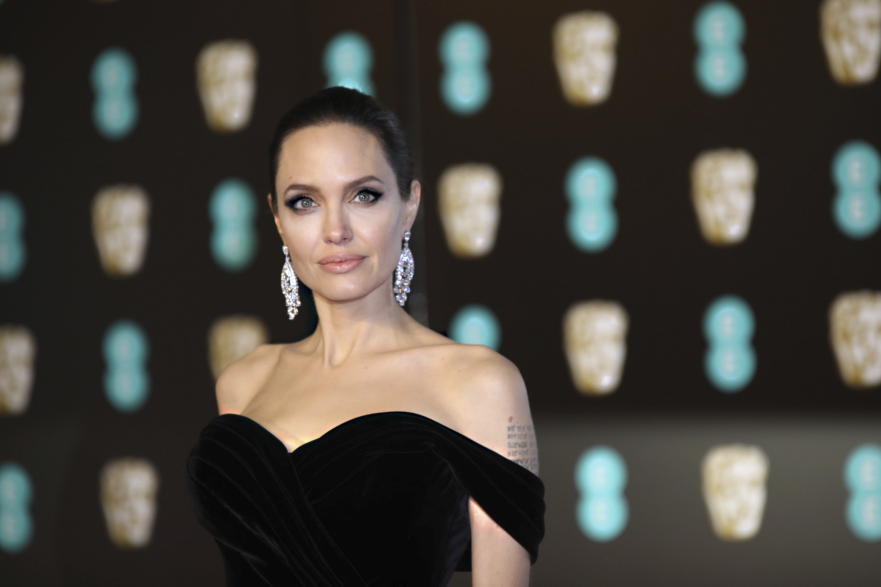 <div class='meta'><div class='origin-logo' data-origin='AP'></div><span class='caption-text' data-credit='Vianney Le Caer/Invision/AP'>Actress Angelina Jolie poses for photographers upon arrival at the BAFTA Awards 2018 in London, Sunday, Feb. 18, 2018.</span></div>