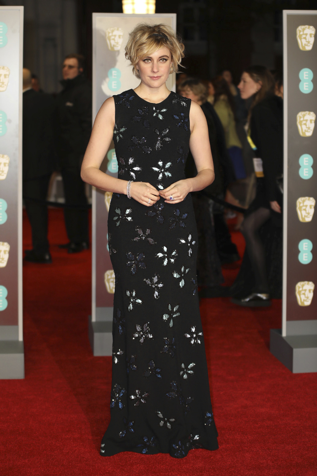 <div class='meta'><div class='origin-logo' data-origin='AP'></div><span class='caption-text' data-credit='Vianney Le Caer/Invision/AP'>Actress Greta Gerwig poses for photographers upon arrival at the BAFTA Awards 2018 in London, Sunday, Feb. 18, 2018.</span></div>