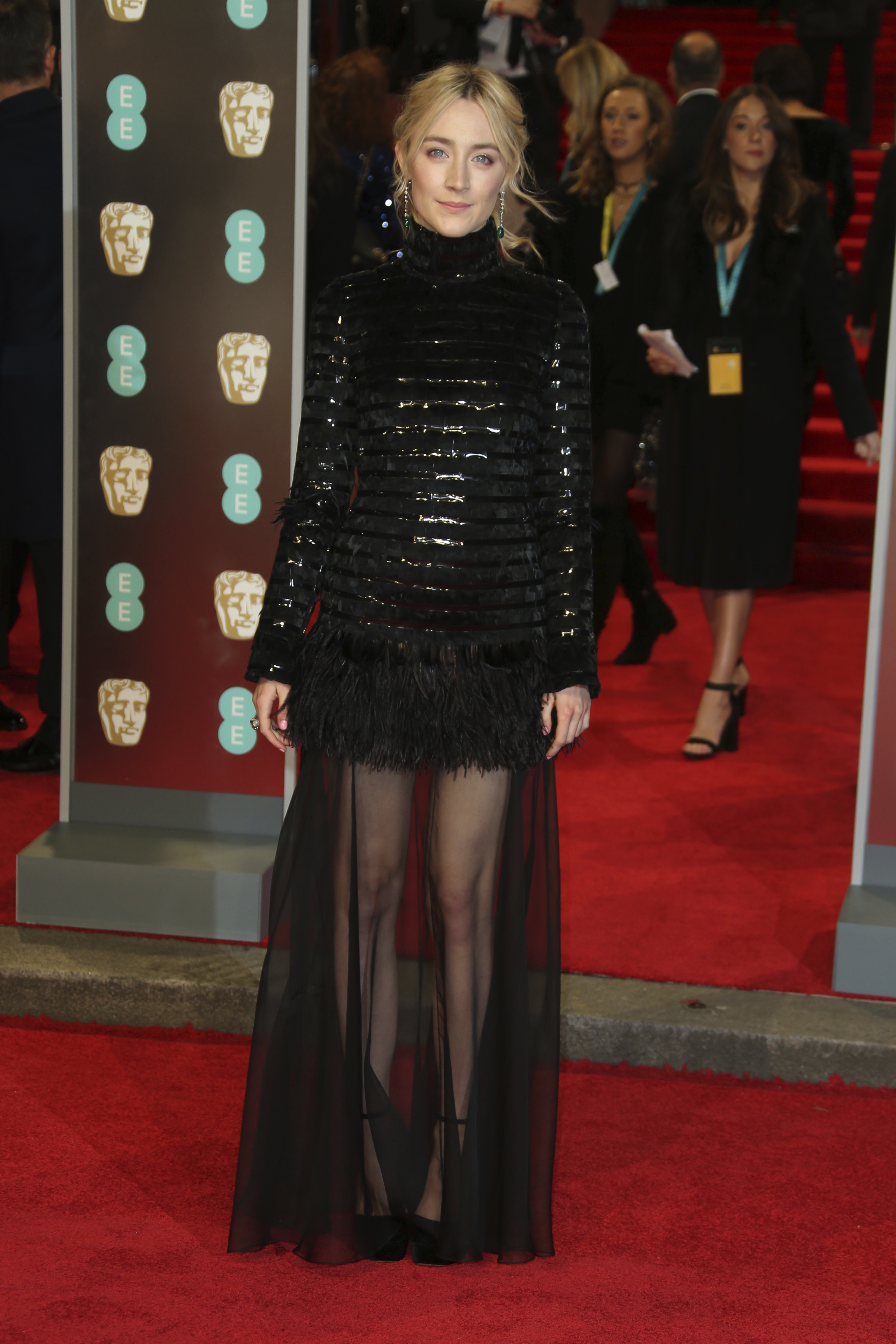 <div class='meta'><div class='origin-logo' data-origin='AP'></div><span class='caption-text' data-credit='Joel C Ryan/Invision/AP'>Actress Saoirse Ronan poses for photographers upon arrival at the BAFTA 2018 Awards in London, Sunday, Feb. 18, 2018.</span></div>