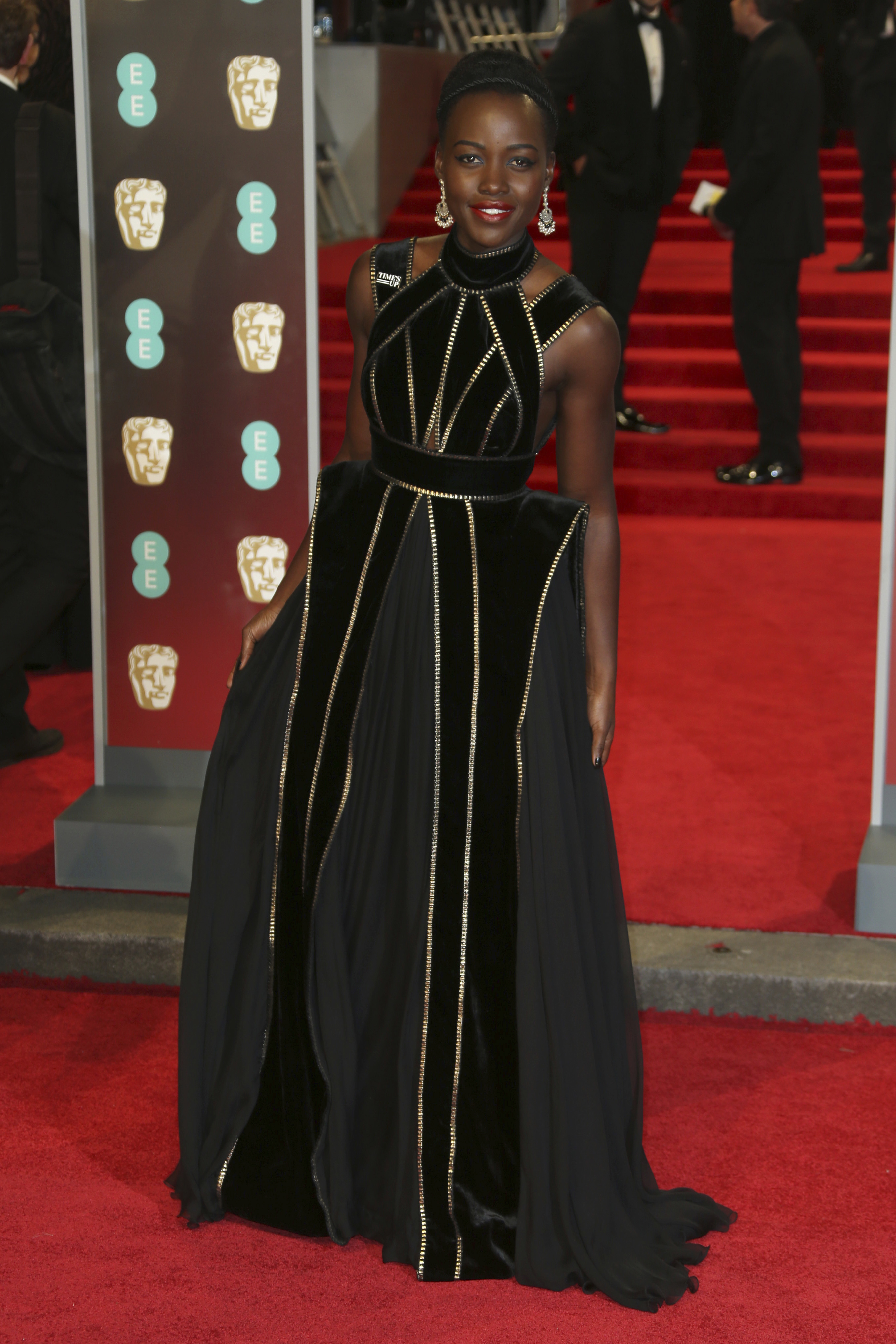 <div class='meta'><div class='origin-logo' data-origin='AP'></div><span class='caption-text' data-credit='Joel C Ryan/Invision/AP'>Actress Lupita Nyong'o poses for photographers upon arrival at the BAFTA 2018 Awards in London, Sunday, Feb. 18, 2018.</span></div>