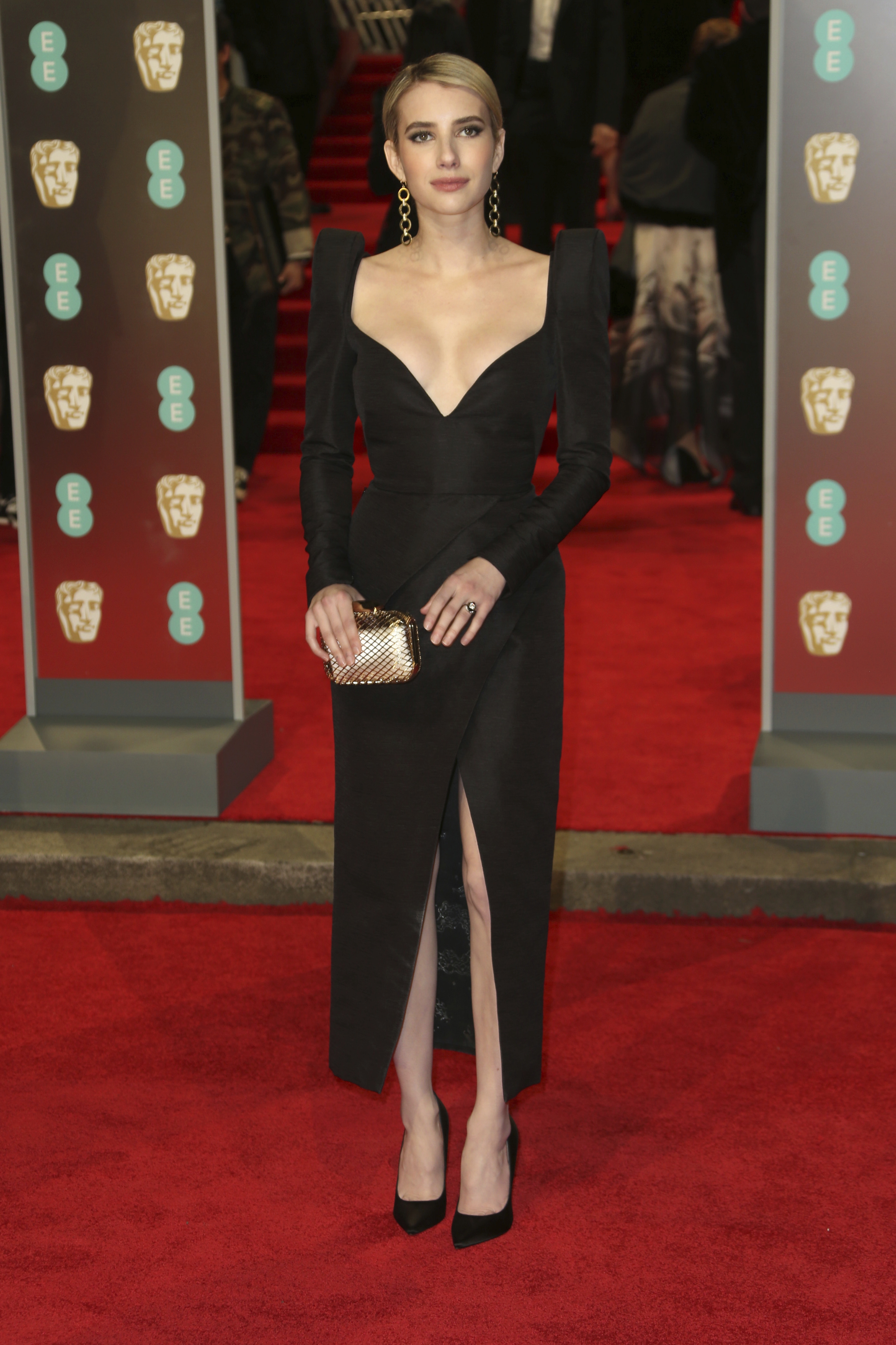 <div class='meta'><div class='origin-logo' data-origin='AP'></div><span class='caption-text' data-credit='Joel C Ryan/Invision/AP'>Actress Emma Roberts poses for photographers upon arrival at the BAFTA 2018 Awards in London, Sunday, Feb. 18, 2018.</span></div>