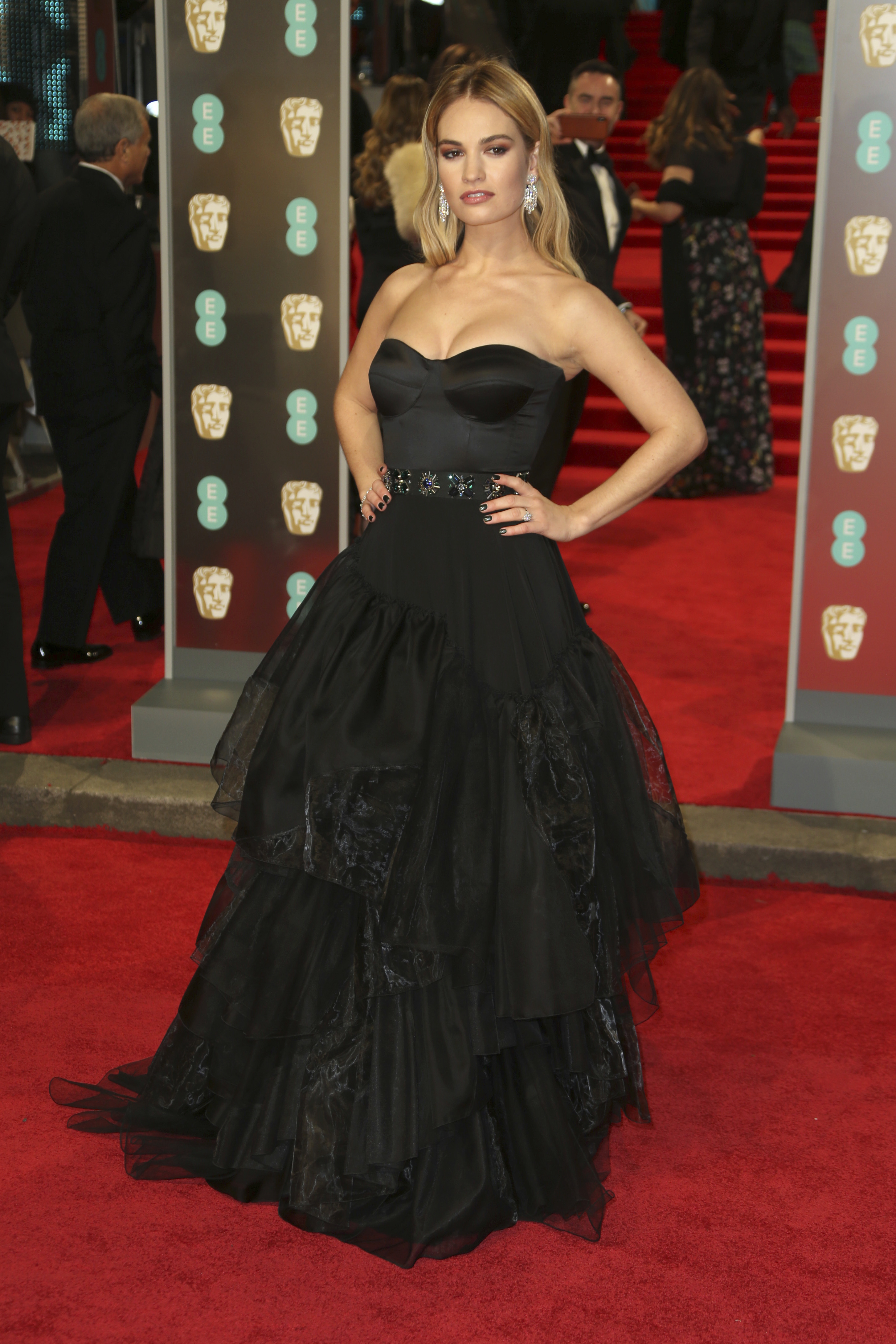 <div class='meta'><div class='origin-logo' data-origin='AP'></div><span class='caption-text' data-credit='Joel C Ryan/Invision/AP'>Actress Lily James poses for photographers upon arrival at the BAFTA 2018 Awards in London, Sunday, Feb. 18, 2018.</span></div>