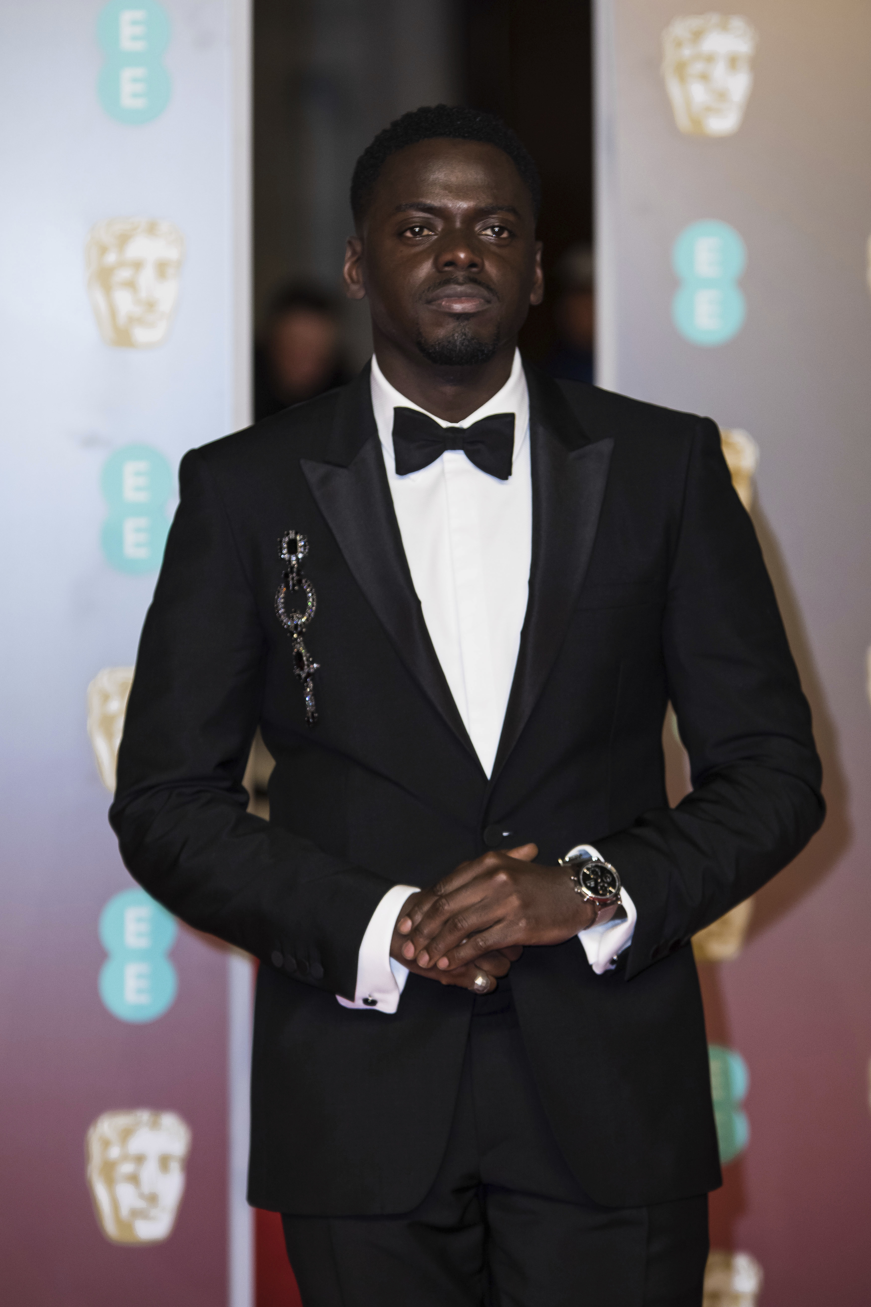 <div class='meta'><div class='origin-logo' data-origin='AP'></div><span class='caption-text' data-credit='Vianney Le Caer/Invision/AP'>Daniel Kaluuya poses for photographers upon arrival at the BAFTA Film Awards, in London, Sunday, Feb. 18, 2018.</span></div>