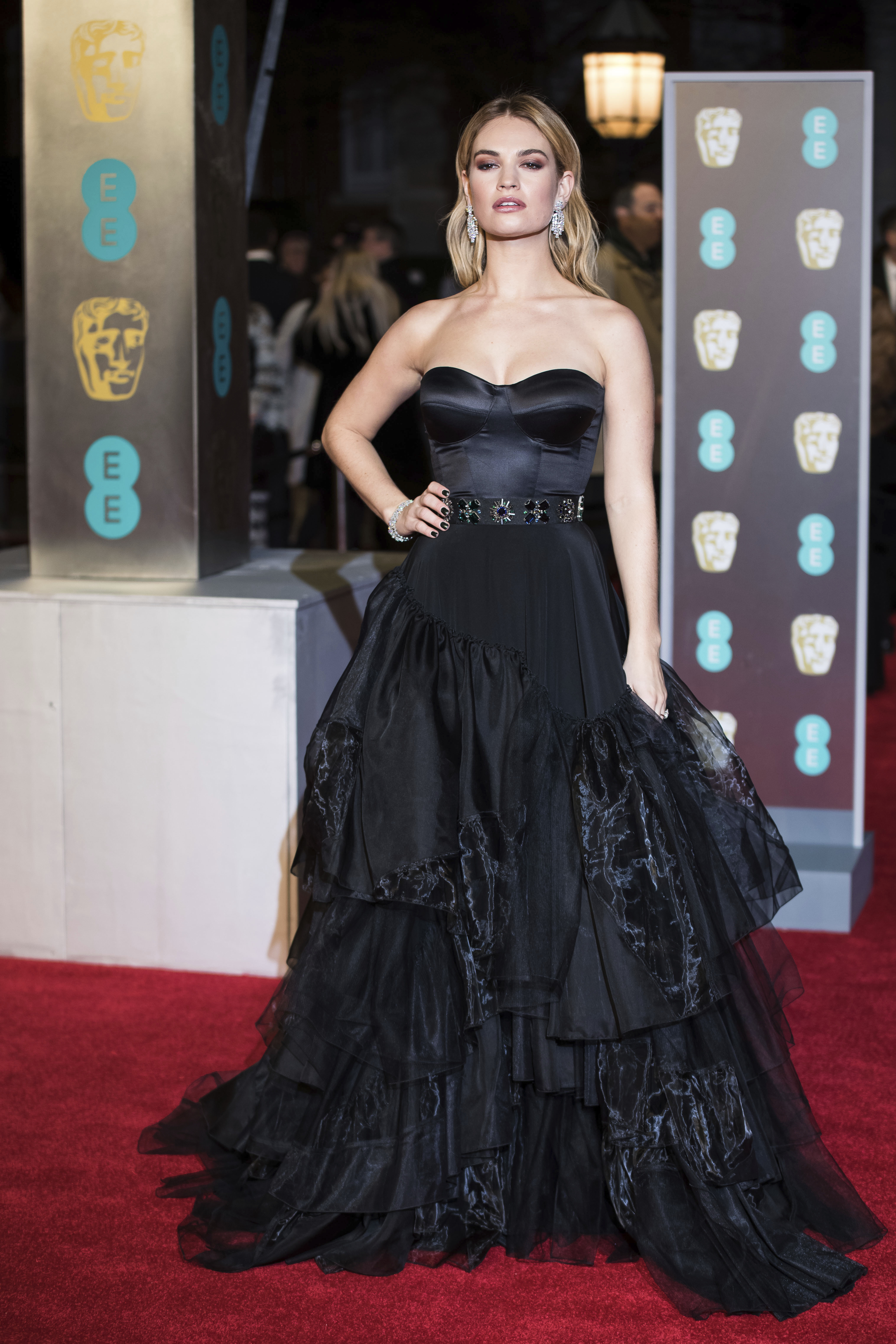 <div class='meta'><div class='origin-logo' data-origin='AP'></div><span class='caption-text' data-credit='Vianney Le Caer/Invision/AP'>Lily James poses for photographers upon arrival at the BAFTA Film Awards, in London, Sunday, Feb. 18, 2018.</span></div>