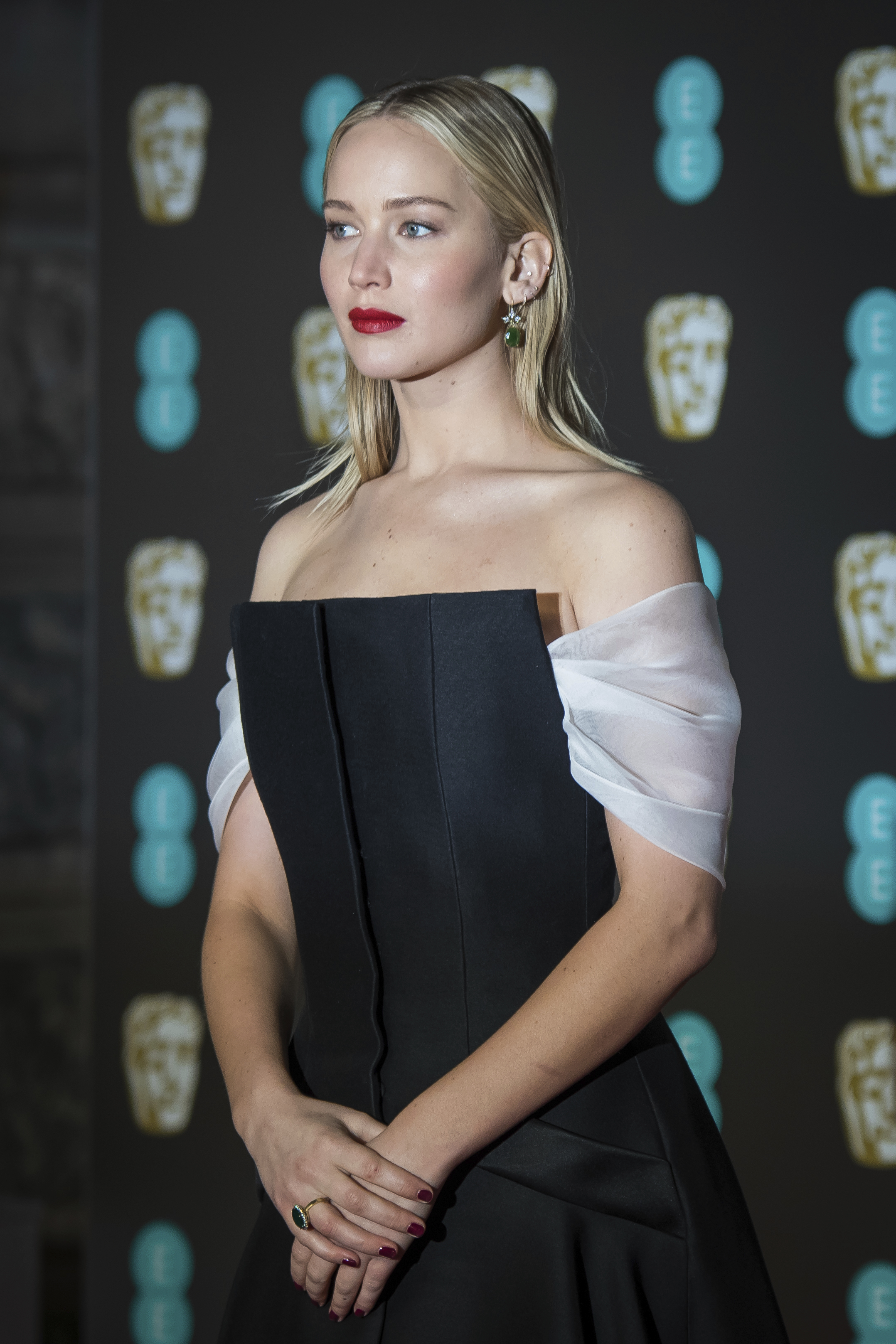 <div class='meta'><div class='origin-logo' data-origin='AP'></div><span class='caption-text' data-credit='Vianney Le Caer/Invision/AP'>Jennifer Lawrence poses for photographers upon arrival at the BAFTA Film Awards, in London, Sunday, Feb. 18, 2018.</span></div>