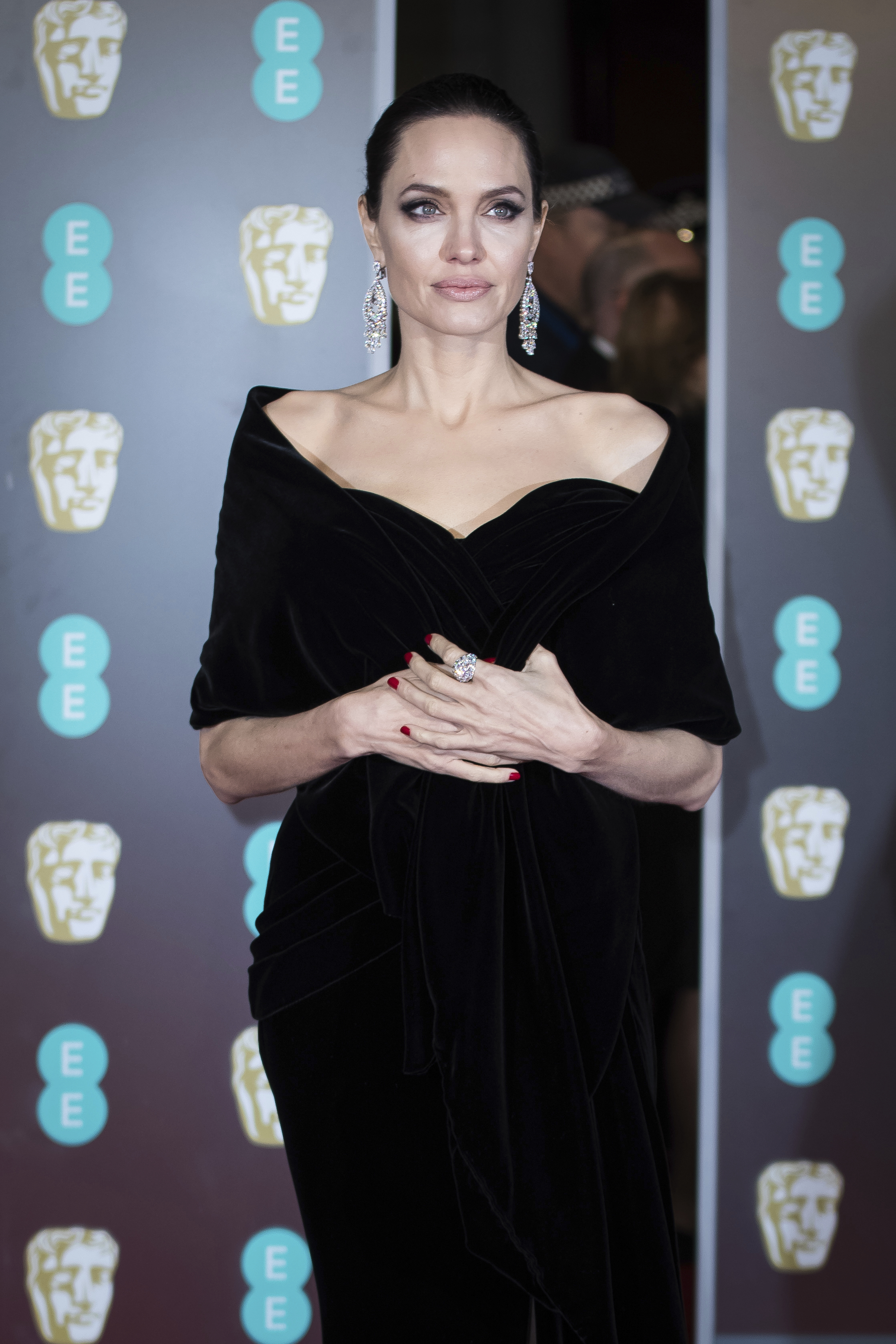 <div class='meta'><div class='origin-logo' data-origin='AP'></div><span class='caption-text' data-credit='Vianney Le Caer/Invision/AP'>Angelina Jolie poses for photographers upon arrival at the BAFTA Film Awards, in London, Sunday, Feb. 18, 2018.</span></div>
